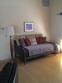 Twin-sized daybed with nice thick mattress, also, a great place to read..