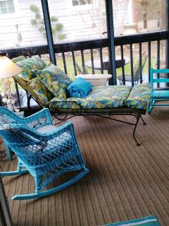 Inside the screened porch. Rockers; lounge; ceiling fan. Quiet, serene view. Great for napping.