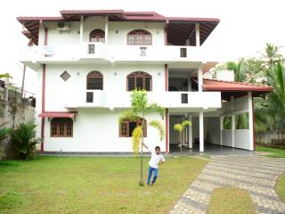 This  is a 5 bed room, three storey house
