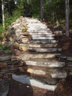 Granite steps down to the lake.