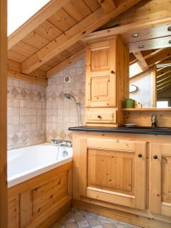 relaxing full length bath under a velux to watch the clouds drift by. large sink, stone top