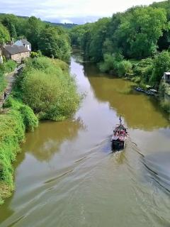 Take a boat trip under the Iron bridge or watch from the armchair at Ironbridge View Townhouse