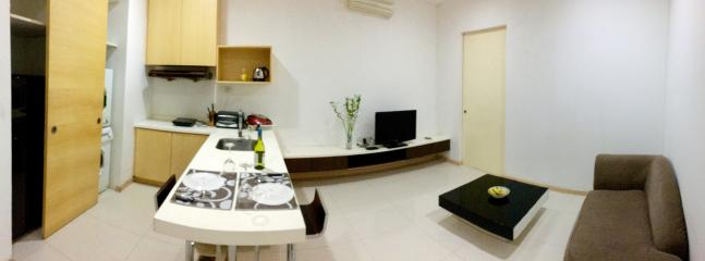 Warm living room with 32' plasma TV, HDMI cable, another air-cond, media player to play movie & song