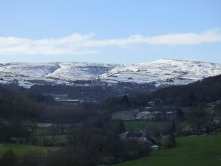 The view from the living room in winter. The hills  are the moors of the Peak District National Park