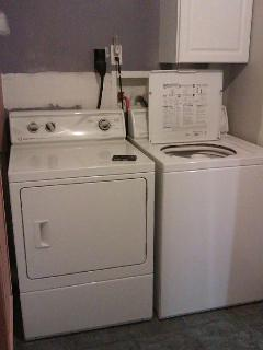 Washer, dryer, ironing board.