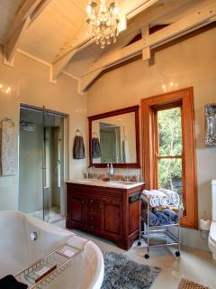 Main bathroom shower and bath. Towels are provided. Relax in a loose standing bath.