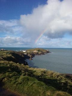 The Headland near Fistral Beach with rainbow