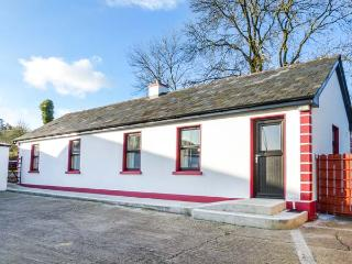 CLOGHEEN COTTAGE, country cottage, open plan living area, solid fuel stove