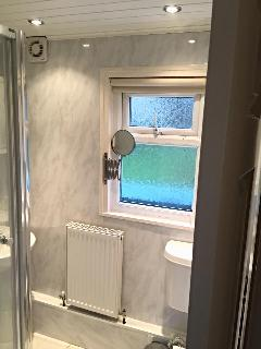 fitted bathroom with shower