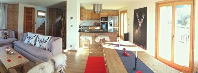 Open plan kitchen, dining and lounge area, with underfloor heating and blue tooth sound system.