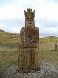 a statue commemorating the Viking Chessmen discovered on nearby Uig Sands (beach)