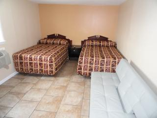 Bedroom with Two Double Beds and Sofa Couch