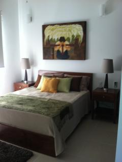 Guest bedroom w queen bed.