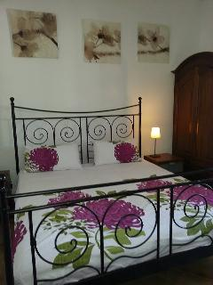 One of the double rooms with aircon and king size bed