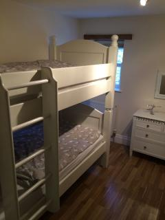 The bunk room, with full size single beds