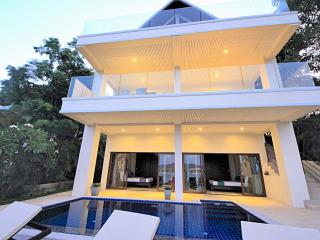Villa overlooks pool with views to the sea.