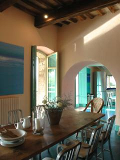 Indoor dining area next to the kitchen and doors opening to the terrace.