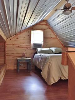Bedroom loft with queen memory foam bed and Himalayan salt lamp