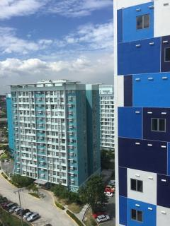View from Hudson Tower 1, Unit T16 showing side of building, with façade of blue tiles.