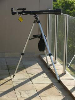 Telescope on balcony for looking out to sea and watching whales