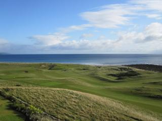 A view from the open window down to the 1st green, 2nd tee and 18th tee