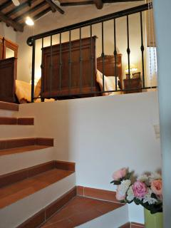 Stairs leading up to the upper first floor bedroom