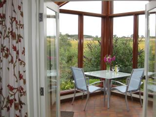 Relaxing in your south facing conservatory admiring the magnificent views and amazing birdlife.