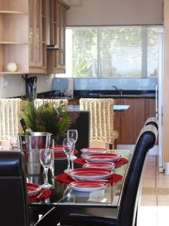 Modern kitchen with granite tops, dishwasher, fridge freezer and double wash basin.