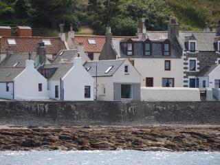 Gannet Cottage is second from left.  Photo taken from a local fishing boat.
