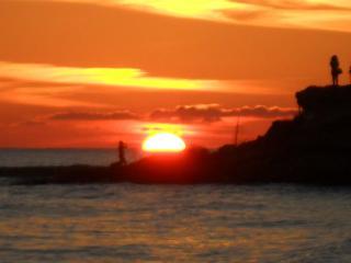 tramonto sulla spiaggia di kaucana