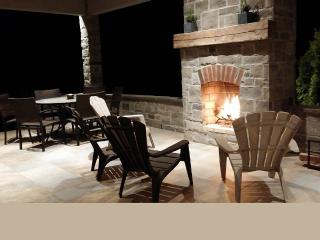 Outdoor wood burning fireplace at night