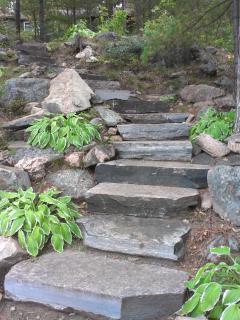 Granite stone walkway down to the dock.