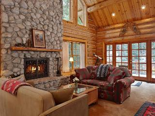 Living room with large fireplace, perfect for gathering.