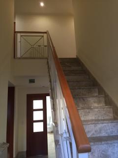 Stairway to 4 bedrooms
