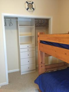 Different view of bedroom with two bunk beds.