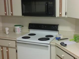 Complete kitchen with pots/pans and dishes.silveirware