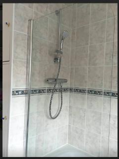 main bathroom with power shower over bath tub