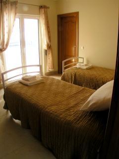 bedroom 4; aircon, poolside, ocean views and shared en-suite