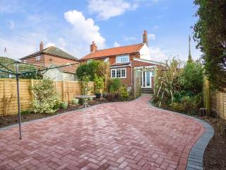 HILLSIDE COTTAGE, red brick property, pet-friendly, close to the coast, in