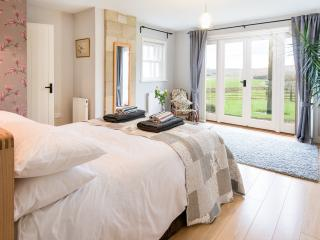 master bedroom with patio doors and great views