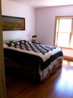 Bedroom, queen bed, memory foam mattress. Armoire.