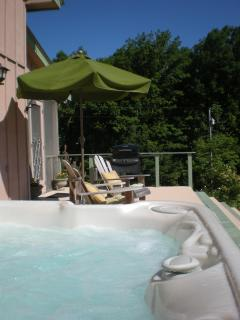 Large deck with gas grill, Adirondack chairs and hot tub with great view.