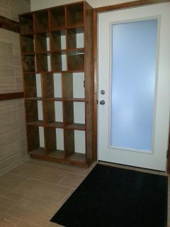 Front Entrance - Tile wall for ski hanging indoors