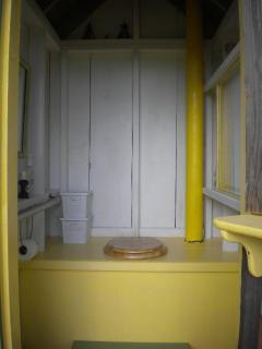 Dry flush composting toilet system