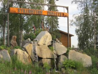 As you enter Stillwaters Chalets you will see our sign, waterfalls, and two life sized brown bears.
