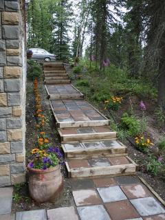 Summer flowers follow the walkway to the Caribou.