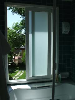 View from en suite bathroom, unusual to have a bath in a Thai house