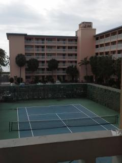 condo and tennis court
