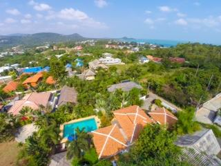 The aerial view from Baan Jasmine towards the sea.