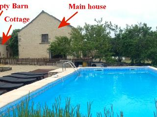 View from pool; empty barn on left, cottage across the courtyard and main house gable end